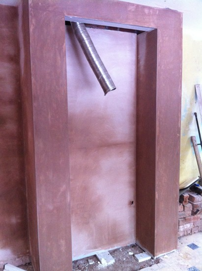 plastered chimney breast. ready for new cooker and extraction unit.