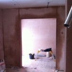 opened door way altered, boarded and plastered