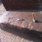 blown bricks. brick wall was taken down and rebuilt