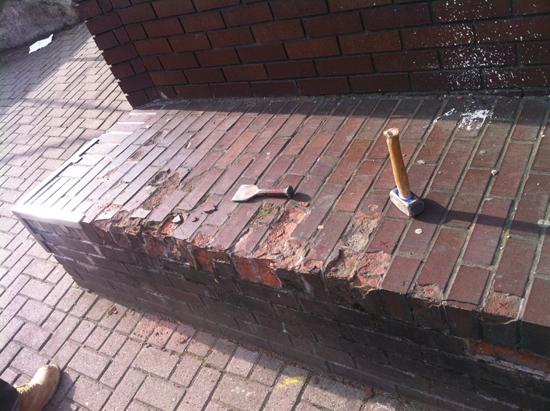 blown bricks. brick wall was taken down and rebuilt