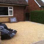 finished driveway. new sub-base, weed control, edgings and cotswild chippings. kineton, warwickshire